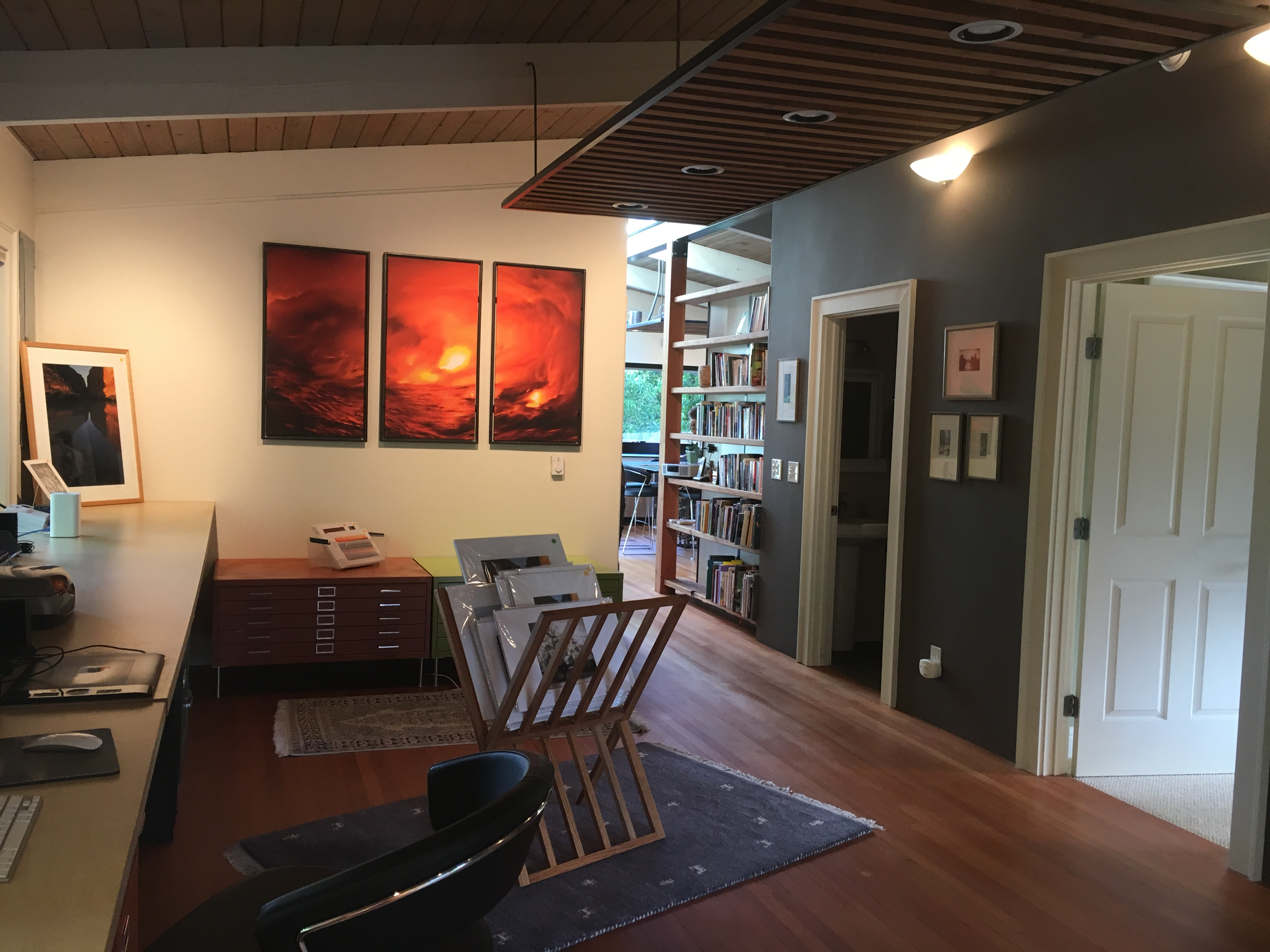 Bright art anchor the space and create flow through the room