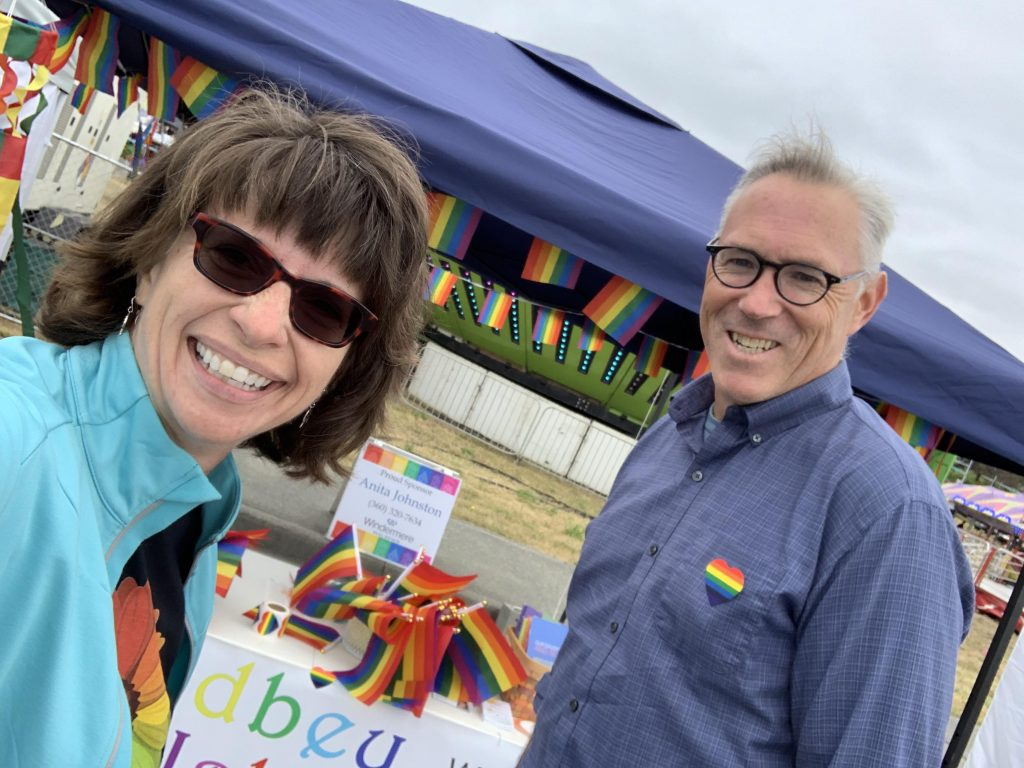 Anita Johnston and Mitch Richards hosting a Whidbey Island Pride booth 4th of July